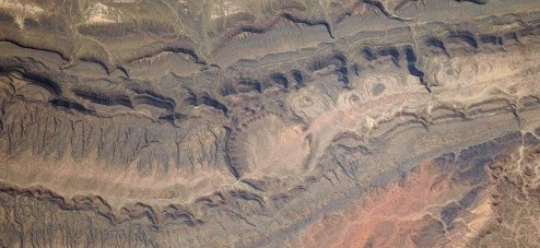 Photograph of the Ouarkziz Impact Crater in Algeria.