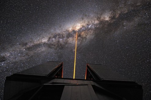 Photograph of a laser being launched by the Paranal Observatory in Chile.